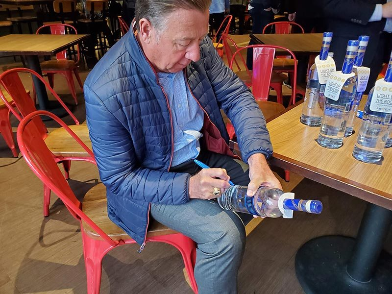 Bernie signing the bottle