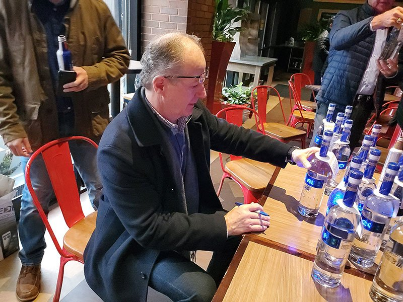 Al McInnis signing the bottle